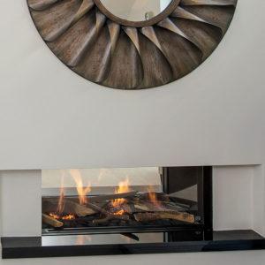 Modern fireplace with statement mirror