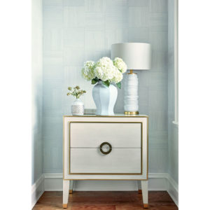 White and gold sideboard with statement lamp and flowers
