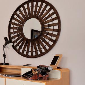 Wooden desk with big statement mirror, decorative items, typewriter and black lamp