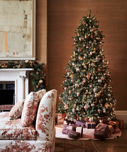 Pink and silver Christmas tree decorations with presents and pink armchair