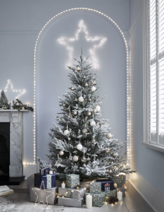 Frosted Christmas tree with silver and white baubles and big light star, with Christmas presents
