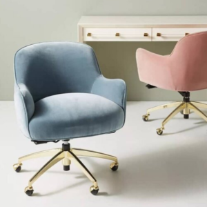 Blue and pink velvet office chairs with a white desk in the background